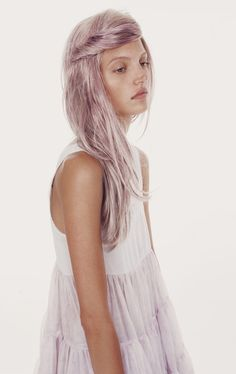silvery lilac hair color..she looks sick and on drugs but I would be able to pull this hair colour off no prob! my goal!