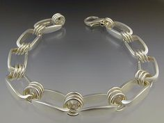 Steven Brixner Sterling Bracelet with thick rectangular shape links. statement. Brixner states that he loves to create pieces that move, catch & reflect light & make sound / Taboo Studio - Contemporary Art Jewelry