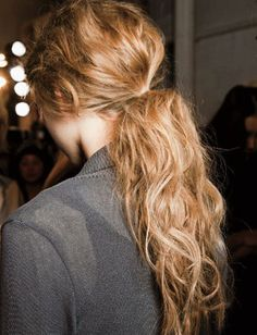 Wavy ponytailMist hair with surf spray to bring out natural waves for a textured ponytail like this one.