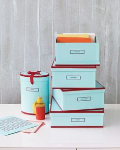 If you have too many DVDs to count, try creating a super-organized system of labeled storage boxes. Label them by genre or put them in alphabetical order. Personalize the boxes with color and stack them virtually anywhere in your home.