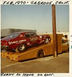 Jungle's beautiful brand-new 1970 red Nova. Car would have only 6 runs on it before Pete Williams crashed it at N.Y. National Speedway on Long Island. Chutes did not come out.  Click this image to show the full-size version.