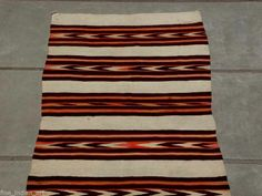 """This is a superb example of a """"Transitional"""" rug as the pattern is a classic shoulder blanket banded design.     A minor stain near one end otherwise in excellent condition.   A rare item to find. Antique American Indian Art Gallery AAIA, Inc. deals in antique & contemporary Native American Indian art and artifacts. We Buy, Sell, Consign, Appraise, Restore & Research. #Antique #American #Indian #Art"""