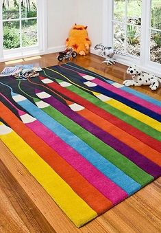 Rugs for kids playroom! Amazing Colorful Playroom Rug Ideas - Options are affordable and versatile for shared boy and girl bedrooms, playrooms or gender neutral nurseries! Inspire imaginative play for toddlers, pre-schools, and elementary age kids! Playroom Rug, Playroom Ideas, Childrens Rugs, Childrens Bedroom, Cool Kids Rooms, Room Kids, Cool Rugs, Classroom Decor, Preschool Classroom