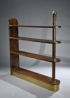 - EUGENE PRINTZ (1889-1948) Exceptional and important bookcase in palm tree veneer, gilded bronze and oxidized brass. Stamped on the lower left with the monogram artist «EP». Circa 1930-1935. 64 1/2 in. (164 cm) high, 86 1/2 in. (155 cm) length, 11 in. (28 cm) depth Provenance : Directly commissioned to Eugène Printz by the ancient owner.