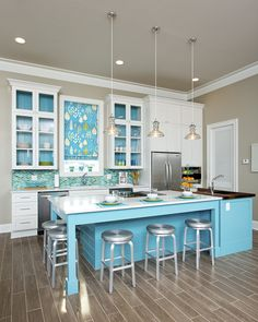 2013 NKBA Design Competition Finalist 'Island in the Sun' by Cheryl Kees Clendenon Here's a perfect rendition of a contemporary twist on a classic beach cottage. This kitchen in a rental was designed for the easy navigation of a large number of guests. The island offers generous seating areas and plenty of counter space aptly crafted to serve multiple cooks. Photo: Greg Riegler Photography