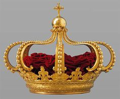 The Crown of John VI, also known as the Portuguese Royal Crown. The crown was made by gold, silver, iron and red velvet in 1817. The base of the crown is elaborately decorated with baroque patterns and designs. It became the official crown of the monarchs of Portugal and was used by all the Portuguese monarchs after John VI. http://en.wikipedia.org/wiki/Crown_of_Jo%C3%A3o_VI