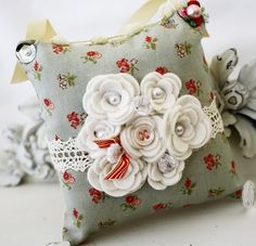 Like the flowers with the button or bead center. Pincushion? Sachet? Nice!