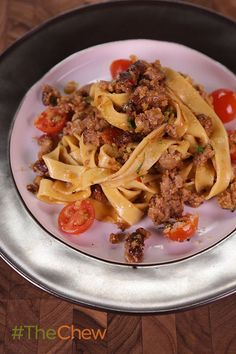 Throw this easy & delicious Creamy Fettuccine with Spicy Sausage and Cherry Tomatoes pasta dish together in no time with ingredients already in your pantry!