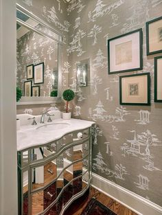 Chinoiserie powder room features walls clad in a gray French toile grasscloth wallpaper lined with a mirrored washstand topped with honed white marble placed under a silver beaded mirror. Chinoiserie Wallpaper, Chinoiserie Chic, Toile Wallpaper, Asian Bathroom, Bathroom Ideas, Bathroom Inspiration, Feature Wall Bedroom, Chic Bathrooms, Country Bathrooms