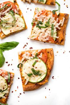 This summery Tomato & Zucchini Quinoa Pizza is a simple, flavorful, plant-based pizza recipe that makes a wonderful meal or appetizer! Vegan & GF as well!