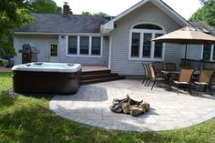 Hot Tub Bullfrog Spas with Trex deck and Cambridge paver patio traditional firepits