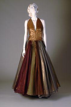 Gold lamé and silk organza evening dress with halter neckline, Madame Grès, 1950s, KSUM 1983.1.407a-d.