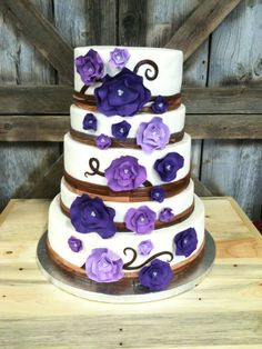RUSTIC WEDDING CAKE WITH MODERN FLOWERS    Posted on December 7, 2012 by mrscakes