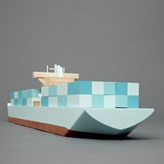 A set of wooden toy ships.