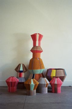 Made using wire lamp shades covered entirely with wool by Ana Kraus
