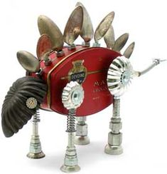 """Name: Spoonasaurus D.O.B.: 5/8/14 Length: 17"""" Principal Components: Chocolate tins, spoons, baking molds, hose fittings, watch parts, flexible oil can spout, pastry tip"""