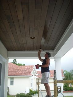 Home Remodeling Outdoor Home Ideas Porch Ceiling Dark Brown Wood Stain - From vaulted to coffered wood, simply paint and beyond, discover the top 70 best porch ceiling ideas. Explore stunning covered space designs for your home. Patio Ceiling Ideas, Porch Ceiling, Plank Ceiling, White Ceiling, Under Deck Ceiling, Shiplap Ceiling, Ceiling Beams, Ceiling Fan, Patio Steps