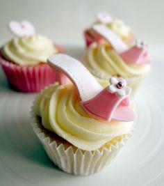 Fondant / gumpaste shoes topped on cupcakes. www.facebook.com/happylbaker