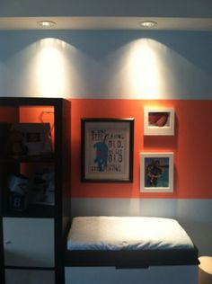 Modern Boy's Neutral Nursery Features Sports and a Coral Stripe