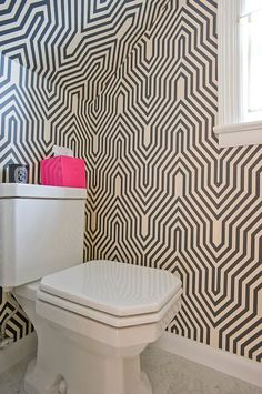 Modern bathroom design with white & black geometric wallpaper...