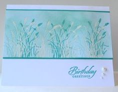 """By Alison Solven. Uses a stamp from """"Wetlands"""" by Stampin' Up. My plan for this card: Sponge a cardstock panel using SU Tempting Turquoise and Pool Party. Stamp the grass 3 times in Tempting Turquoise. Stamp the grass 4 times in VersaMark & heat emboss with white powder. Mount on a Tempting Turquoise panel, then on a white card base. Add sentiment & pearls."""