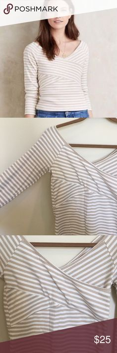 Anthropologie Deletta striped wrap top size small Anthropologie Deletta white and tan striped wrap top. Stretchy ribbed fabric, with a wrap detail across chest for a flattering look. Could be worn off the shoulder as well. Size small. EUC. Offers welcome. Bundle and save.   :::A7 Anthropologie Tops Tees - Long Sleeve