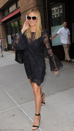 All in a day's work! Heidi Klum was ready to turn every head at work when she stepped outside of her New York City hotel on Friday, clad in a vampy black mini dress