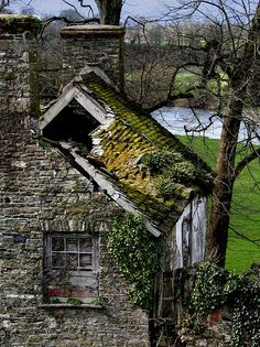 A once pretty but now derelict house by a river, via Flickr., in Carmarthenshire County, Wales.