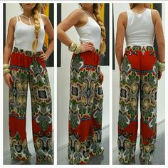 """🆕Palazzo wide leg pants NWOT 🆕Brand new, no tags   Wide leg pants with a fabulous bohemian print!! Complimentary color combination! High waisted. Light weight and breezy material. Pair with heels and a tank top or crop top and you are looking HOT. Size large Length approx42.5"""" Inseam approx31.5"""" Rise approx 12"""" Elastic bands at waist to provide stretch. 100%polyester  👍👍Made is the USA👍👍  💗NO TRADES 💗Price is firm unless bundled Pants Wide Leg"""
