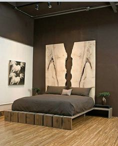 I like the idea of the artwork behind the bed.