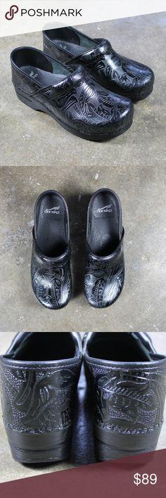 Dansko black leather tooled clogs Sz 41.  Dansko black leather tooled clogs.  Paisley/floral textured print.  Only very slight wear, see photos. Dansko Shoes Mules & Clogs