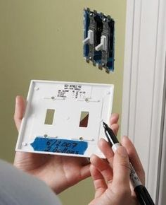 Write the name of the paint color and swatch number and date painted on painter's tape on back of light switch for each room.