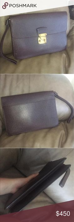 Louis Vuitton's Vintage Classy Taiga Kourad sp1925 Item is in very good condition! No odor or stickiness Louis Vuitton Bags Clutches & Wristlets