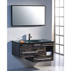This stylish vanity features a striped green and blue glass top that matches perfectly with the striped wood veneer construction in the same colors. Highlighted by brushed nickel hardware, this vanity offers a single-sink style.