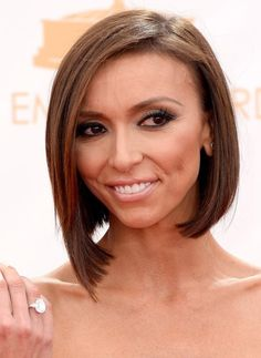 2014 Giuliana Rancic's Short Hairstyles: Angular Asymmetrical Bob Giuliana Rancic's asymmetrical smooth short hairstyle is quite fashionable and smashing. One length is trimmed round her jaw line and the other side is kept longer nearly reaching her shoulder. It is a cool option for people searching for a hairstyle to balance out a long face shape -