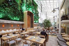 The customer's idea is to create a designer bistro in a covered area between a historical mansion and mall's wall.A room for the restaurant is located in quite a complex covered space — between the face of a historical mansion an… Luxury Restaurant, Restaurant Lounge, Modern Restaurant, Restaurant Interior Design, Bar Lounge, Thailand Restaurant, Interior Shop, Contemporary Dining Table, Contemporary Interior Design