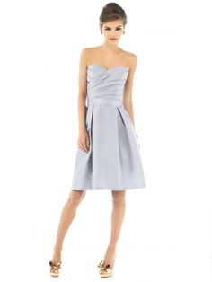 """Cocktail length strapless dupioni dress w/ draped asymmetrical bodice. Matching 1.75"""" self belt at natural waist. Full pleated skirt has pockets at side seams. Also available full length as style D537."""
