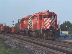 Late evening at Burlington, Ontario in the early 1980's Canadian Pacific Railway SD40 #5548 heads another SD40 on a westbound freight to Hamilton.