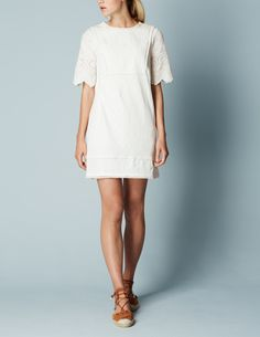 This boho-inspired tunic (in lightly textured slub cotton) features pretty, woven broderie detailing on the sleeves and front. Light and easy-to-wear, it's a holiday essential.