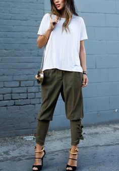 Full front view of model in buckled-hem army green harem pants