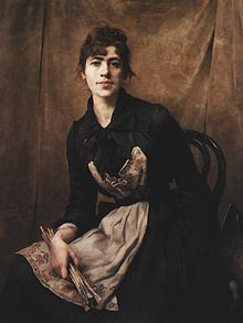 Self-Portrait with Apron and Brushes- Anna Bilińska-Bohdanowicz.  She innovated a new self-portrait pose by placing the artist in front of a model's backdrop, thus stating that she is her own model.[1] She also painted still lifes, genre scenes and landscapes, and was a representative of