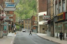 People walk down McDowell Street in Welch, West Virginia. Description from blogs.voanews.com. I searched for this on bing.com/images