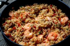 Recipe for rice with chorizo and shrimp, also known as arroz con chorizo y camarones, made with rice and chorizo cooked in a seafood broth with shrimp, onions, peppers, garlic, tomatoes, and parsley.