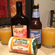 FUZZY MOON!  4 blue moons  1 can frozen orange juice 1 shot of peach schnapps  Mix together, pour and enjoys. Perfect summer drink!