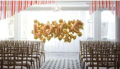 Use letter-shaped balloons as a fun element in decorating!    From paperdoll, http://paperdollstudio.ca/blog/
