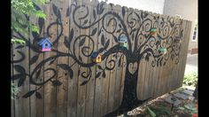 Added hand painted birdhouses to the tree of life. My granddaughter helped with the painting.