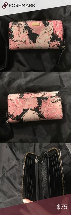 Pink Feather Kate Spade Wallet This wallet is in really good condition. Only used for a couple months! There is a little bit of wear on the gold plate hat says 'Kate Spade' but not really noticeable at all. kate spade Bags Wallets