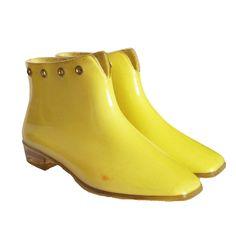 Rare vintage 60s Mary Quant Afoot yellow plastic rain boots ankle boots with rivets Uk 6, Eu 39, Us 8.5, Au 7. £135.00, via Etsy.