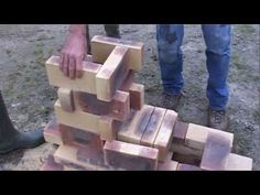 rocket stove construction - excellent video on rocket stove mass heater - uses 55 gallon drum, reuses a hot water heater, and fire brick.
