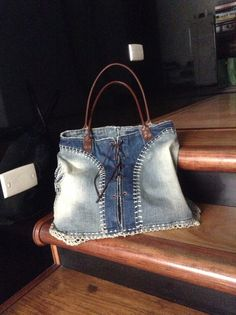 a denim skirt with crochet details turned into an amazing bag!